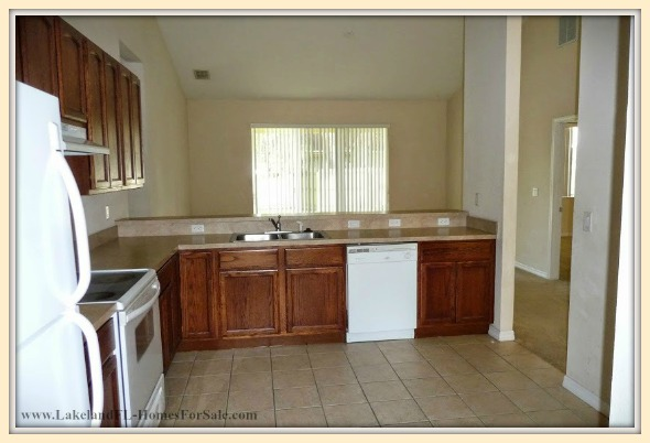 Enjoy every breakfast or midnight snack in the large breakfast bar of this lovely Lakeland FL home for sale.