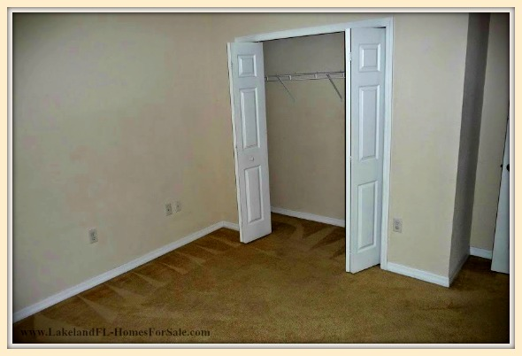 Delight in the large master bedroom in this cozy Lakeland FL home for sale.
