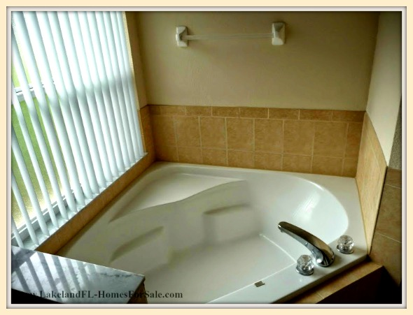 Have a relaxing bath in the garden tub of this beautiful Lakeland FL home for sale