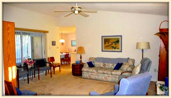 You can relax and watch the scenery outside while inside the spacious living room of this fantastic Sandpiper Golf and Country Club home for sale.