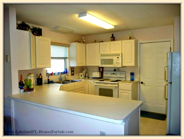 Stir up a delicious meals in the fully functional kitchen of this Lakeland FL home for sale.