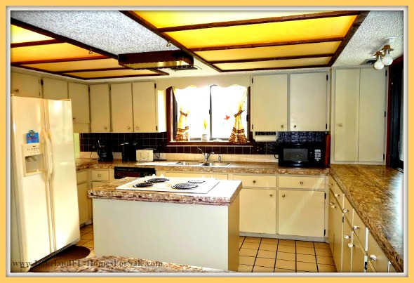 This 4 bedroom Lake Wales FL home for sale boasts of an expansive kitchen perfect for any kind of cooking.