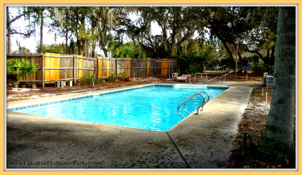 Take a night dip in the large pool of this 4 bedroom home for sale in Lake Wales FL.