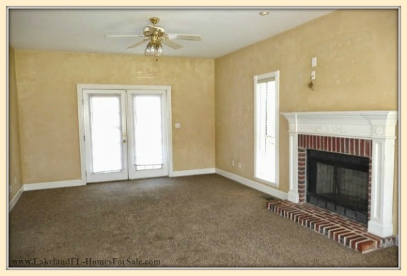 Get warm and cozy inside the living room of this majestic Lakeland FL home for sale.