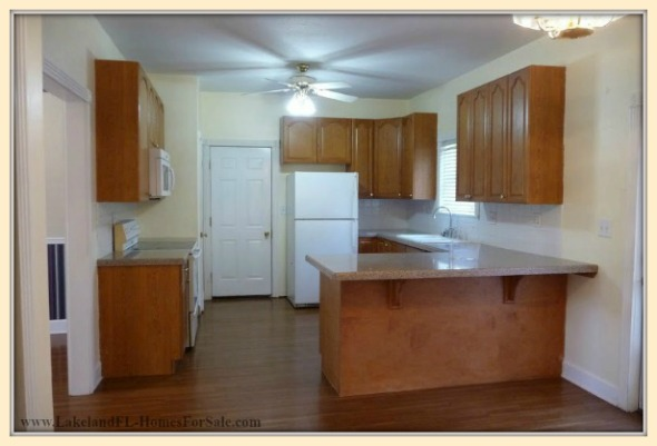 Enjoy all home cooked meals in the open floor designed kitchen of this colonial home for sale in Lakeland FL.