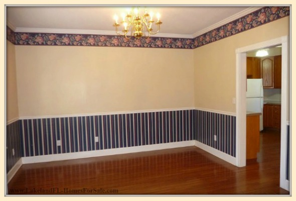 The formal dining room in this elegant Lakeland FL home for sale will surely impress your guests.