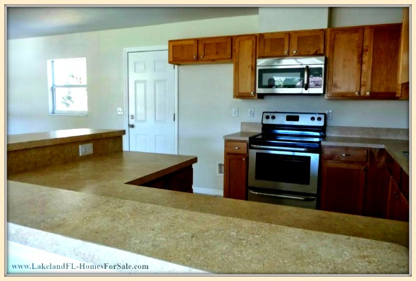 Bring out the chef in you while preparing meals in the open kitchen of this gorgeous Lakeland FL home for sale.