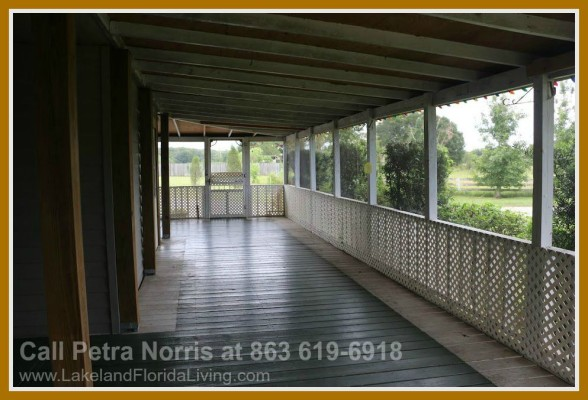 Having your coffee along the spacious porch of this home for sale in Kathleen FL will surely be an pleasurable experience as you take in the lush greens surrounding the property.
