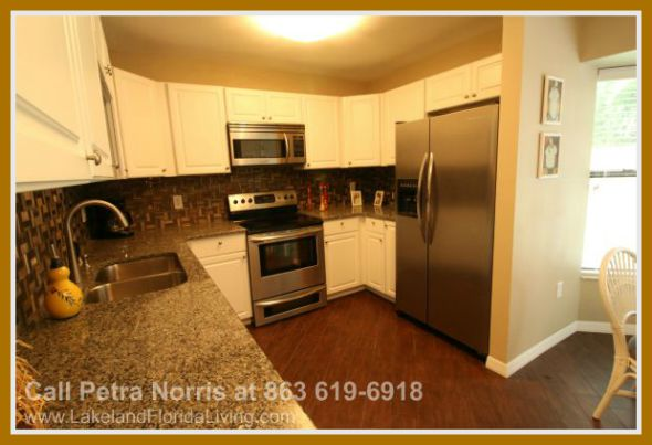 This Kenilworth Park 3 bedroom home for sale in Winter Haven FL boasts of a functional kitchen perfect for preparing large sumptuous meals.