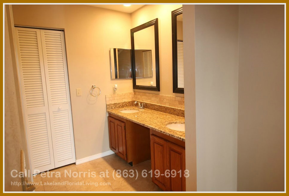 An immaculate bathroom awaits you in the master bedroom of this home for sale in Lakeland FL.
